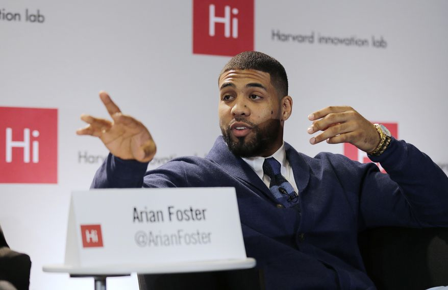 Houston Texans running back Arian Foster gestures as he answers a question during a panel discussion at Harvard University in Cambridge, Mass., Wednesday, April 23, 2014. Foster was a featured speaker in a panel that spoke on topics of race and aspects of social media. (AP Photo/Charles Krupa)