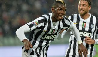 Juventus midfielder Paul Pogba, of France, celebrates after scoring during a Serie A soccer match between Juventus and Bologna at the Juventus stadium, in Turin, Italy, Saturday, April 19, 2014. (AP Photo/Massimo Pinca)
