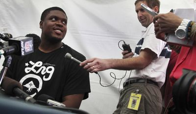 """FILE - In this July 24, 2013 file photo, Denver Broncos offensive lineman Ryan Clady answers questions from the media at training camp in Englewood, Colo. Clady spent most of last season watching Denver break records from the sideline after injuring his left foot in just his second game after signing a $52.5 million contract. Peyton Manning says Clady's return to the Broncos offensive line this year is """"almost like a free agent acquisition.""""  (AP Photo/Brennan Linsley, File)"""