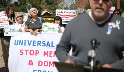 Tom Sullivan, who's son Alex was killed in the 2012 Aurora movie theatre massacre, speaks at a rally against gun violence in front of Republican Congressman Mike Coffman's office, in Aurora, Colo., Wednesday April 23, 2014. Sullivan  and other parents of Aurora theater shooting victims urged Coffman to support universal background checks in Congress. (AP Photo/Brennan Linsley)