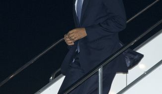 U.S. President Barack Obama steps from Air Force One as he arrives at Haneda International Airport in Tokyo, Wednesday, April 23, 2014. Obama began a four-country trip through the Asia-Pacific region. (AP Photo/Carolyn Kaster)