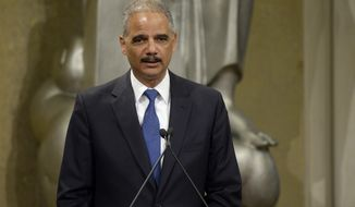 Attorney General Eric Holder speaks at the Justice Department's Diversity and Inclusion Speaker Series, Wednesday, April 23, 2014, in the Great Hall at the Justice Department in Washington.  (AP Photo/Susan Walsh)