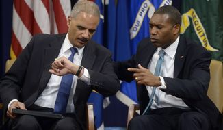 Attorney General Eric Holder, left, with Associate Attorney General Tony West at the Justice Department in Washington. (AP Photo/Susan Walsh)