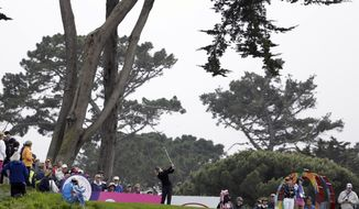 Suzann Pettersen, center, of Norway hits from the third tee of the Lake Merced Golf Club during the first round of the Swinging Skirts LPGA Classic golf tournament on Thursday, April 24, 2014, in Daly City, Calif. (AP Photo/Eric Risberg)
