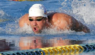 Michael Phelps competes in the 100-meter butterfly final during the Arena Grand Prix, Thursday, April 24, 2014, in Mesa, Ariz. Ryan Lochte won, and Phelps finished in second place. He was competing for the first time since the 2012 London Olympics. (AP Photo/Matt York)