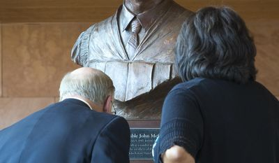 A bust of the late Judge John Roll is in the lobby of the John M. Roll U.S. Courthouse in Yuma, Ariz. Roll was among six people who died in front of the Tucson grocery store after stopping by to greet U.S. Rep. Gabrielle Giffords. (AP Photo/The Arizona Republic, Charlie Leight)