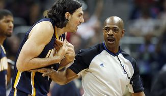 Indiana Pacers forward Luis Scola, left, argues with an official in the first half of Game 3 of an NBA basketball first-round playoff series against the Atlanta Hawks, Thursday, April 24, 2014, in Atlanta. (AP Photo/John Bazemore)