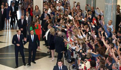 Britain's Prince William, center left,  is accompanied by Prime Minister Tony Abbott, center right, as they arrive for a reception Thursday, April 24, 2014, at Parliament House in Canberra, Australia. (AP Photo/Alex Ellinghausen, Pool)