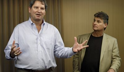 "FILE - In this Jan. 10, 2013 file photo, former Cleveland Browns quarterback Bernie Kosar, left, speaks at a news conference with Dr. Rick Sponaugle, in Middleburg Heights, Ohio . Thursday, Jan. 10, 2013. Kosar believes he's been unfairly sacked as a TV broadcaster. Kosar contends he's been removed because of slurred speech he attributes to ""a direct result of the many concussions I received while playing in the NFL."" (AP Photo/Mark Duncan, File)"