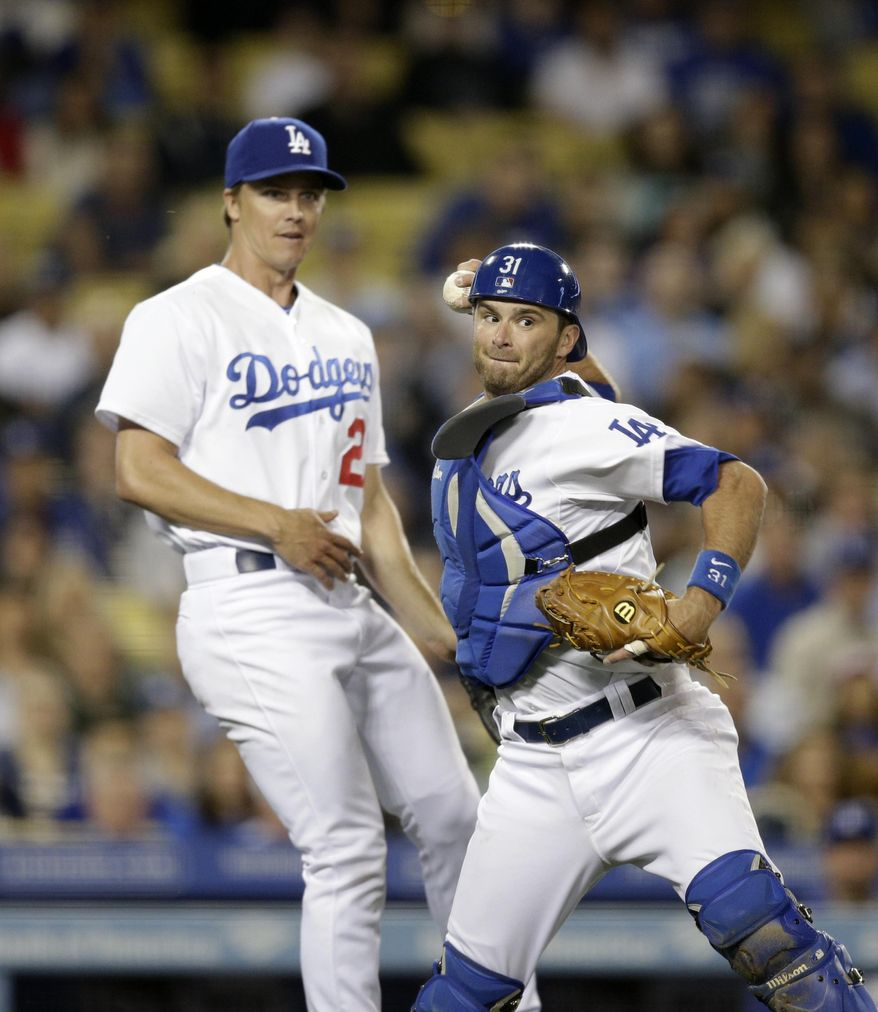 Los Angeles Dodgers catcher Drew Butera, right, throws the ball to first base for the out on Philadelphia Phillies' Marlon Byrd as starting pitcher Zack Greinke watches during the sixth inning of a baseball game on Wednesday, April 23, 2014, in Los Angeles. (AP Photo/Jae C. Hong)