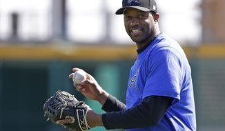 In this Feb. 12, 2014, photo, retired NBA basketball player Tracy McGrady smiles while working out at the Sugar Land Skeeters' baseball stadium in Sugar Land, Texas. McGrady signed Wednesday, April 23, to pitch for the Skeeters in the independent Atlantic League. (AP Photo/Pat Sullivan)