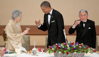 Mr. Obama, Japanese Emperor Akihito and his wife Empress Michiko raise their glasses in a toast during a state dinner at the Imperial Palace in Tokyo, Thursday.