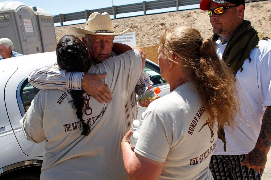 Rancher Cliven Bundy hugs a supporter before holding a press conference near Bunkerville, Nev. Thursday, during which Mr. Bundy denied Thursday that he was a racist. (Associated Press)