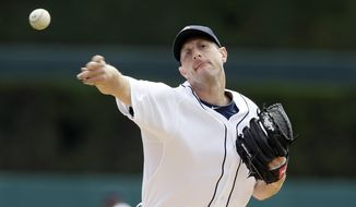 Detroit Tigers starting pitcher Max Scherzer throws warmup pitches before the first inning of a baseball game against the Chicago White Sox in Detroit, Thursday, April 24, 2014. (AP Photo/Carlos Osorio)