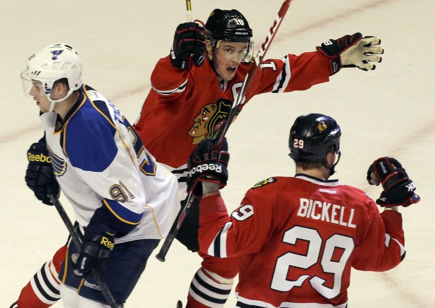 Chicago Blackhawks' Bryan Bickell (29) celebrates with Jonathan Toews (19) after scoring his goal as St. Louis Blues' Vladimir Tarasenko (91) reacts during the third period in Game 4 of a first-round NHL hockey playoff series in Chicago, Wednesday, April 23, 2014. The Blackhawks won 4-3 in overtime. (AP Photo/Nam Y. Huh)