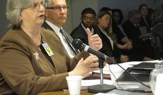 Federal public defender Vicki Werneke, left, argues for mercy for death row inmate Arthur Tyler before the Ohio Parole Board while fellow public defender Alan Rossman observes, on Thursday, April 24, 2014, in Columbus, Ohio. Tyler's lawyers say he is innocent and should be freed, while prosecutors say his death sentence should be commuted to life in prison because of questions about his case. (AP Photo/Andrew Welsh-Huggins)