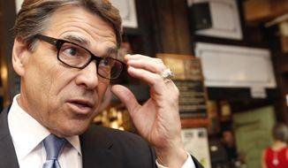 FILE - In this April 23, 2014 file photo, Texas Gov. Rick Perry speaks to the media after meeting with business owners in New York. A Texas land dispute has Perry and the Republican candidate favored to replace him, Greg Abbott, decrying the same federal agency currently embroiled in an armed standoff in Nevada. (AP Photo/Kathy Willens, File)