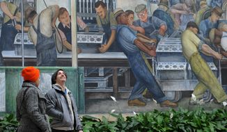 In a Jan. 14, 2014 photo, Vita Kossuth, 19, left, from Troy, and John-Paul Davis, 26, Rochester, take in the famous Diego Rivera murals at the  the Detroit Institute of Arts in Detroit. Federal officials announced Wednesday, April 23, 2014 that Diego Rivera's murals at the Detroit Institute of Arts have been designated as one of four new national historic landmarks. (AP Photo/The Detroit News, Brandy Baker)