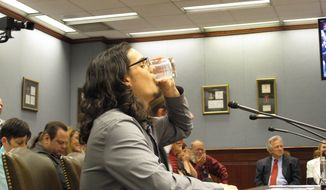 Dustin Soileau of Lafayette drinks a glass of raw milk after speaking to the House Agriculture Committee on Thursday, April 24, 2014, in Baton Rouge, La. Soileau was supporting a bill to allow Louisiana farms to sell raw milk to consumers. (AP Photo/Melinda Deslatte)