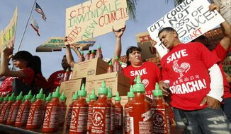 Sriracha hot sauce workers protest ahead of the city council meeting in Irwindale, Calif., Wednesday, April 23, 2014. The Irwindale City Council has declared that the factory that produces the popular Sriracha hot sauce is a public nuisance. (AP Photo/Damian Dovarganes)