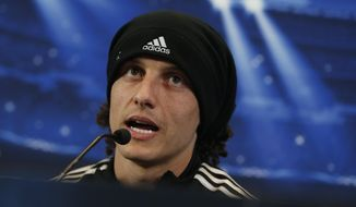 Chelsea's David Luiz speaks during a press conference at the Vicente Calderon stadium, in Madrid, Spain, Monday April 21, 2014, ahead of the Champions League semifinal first leg soccer match against Atletico Madrid on Tuesday. (AP Photo/Andres Kudacki)