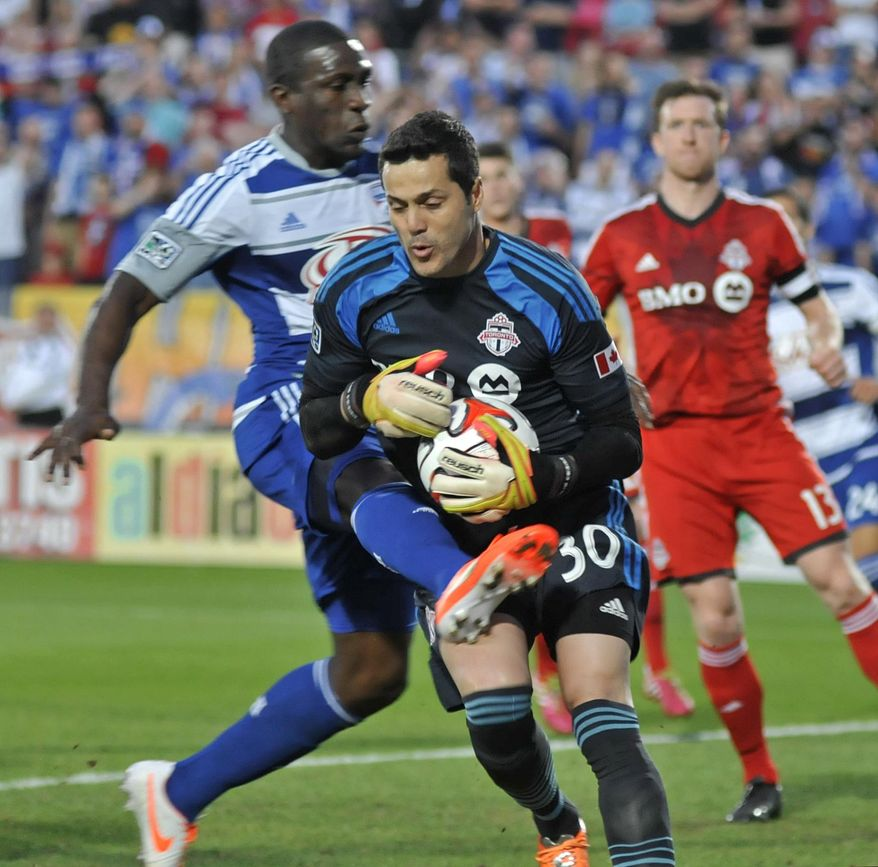 FC Dallas' Hendry Thomas, left, kicks as Toronto FC goalkeeper Julio Cesar (30) controls the ball and Toronto's Steven Caldwell (13) observes during an MLS soccer game on Saturday, April 19, 2014, in Frisco, Texas. (AP Photo/The Dallas Morning News, Mark M. Hancock) MANDATORY CREDIT, NO SALES, MAGAZINES OUT, TV OUT, INTERNET USE BY AP MEMBERS ONLY