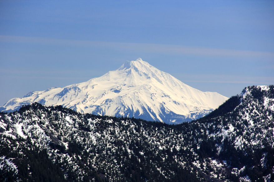 In this photo taken on April 10, 2014, Mount Jefferson dominates the eastern skyline from the summit of Whetstone Mountain in Willamette National Forest east of Salem, Ore., in the Opal Creek Wilderness area. (AP Photo/Statesman Journal, Zach Urness)