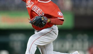 Los Angeles Angels relief pitcher Ernesto Frieri throws against the Washington Nationals during the ninth inning of a baseball game, Wednesday, April 23, 2014, in Washington. The Nationals won 5-4. (AP Photo/Pablo Martinez Monsivais)