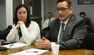 Allan Regas, right, Assistant Cuyahoga County Prosecutor, explains to the Ohio Parole Board why his office is seeking clemency for condemned killer Arthur Tyler, while Katherine Mullin, also an Assistant Cuyahoga County Prosecutor, listens in, on Thursday, April 24, 2014, in Columbus, Ohio. Regas says his office maintains Tyler is guilty, but says the case wouldn't meet current standards for a capital punishment prosecution. (AP Photo/Andrew Welsh-Huggins)