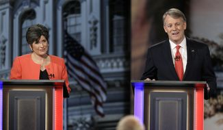 Iowa Republican senatorial candidate retired CEO Mark Jacobs speaks during a live televised debate as fellow candidate state Sen. Joni Ernst, left, looks on at Iowa Public Television studios, Thursday, April 24, 2014, in Johnston, Iowa. (AP Photo/Charlie Neibergall)