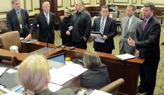 Ohio Rep. Pete Beck, second from right, isflanked by his attorneys, Ralph Kohnen, right, and Chad Ziepfel and other parties involved in his case during a hearing in Hamilton County court Thursday, April 24, 2014, in Cincinnnati. Beck's trial on charges of fraud and theft was set for Nov. 17, and his former business partner is expected to testify against him. The 61-year-old has denied the allegations and brushed away calls to resign. (AP Photo/Amanda Lee Myers)