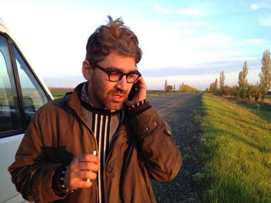 This is reportedly the first image captured of Vice News reporter Simon Ostrovsky since his capture in Ukraine. (J-Francois Belanger)