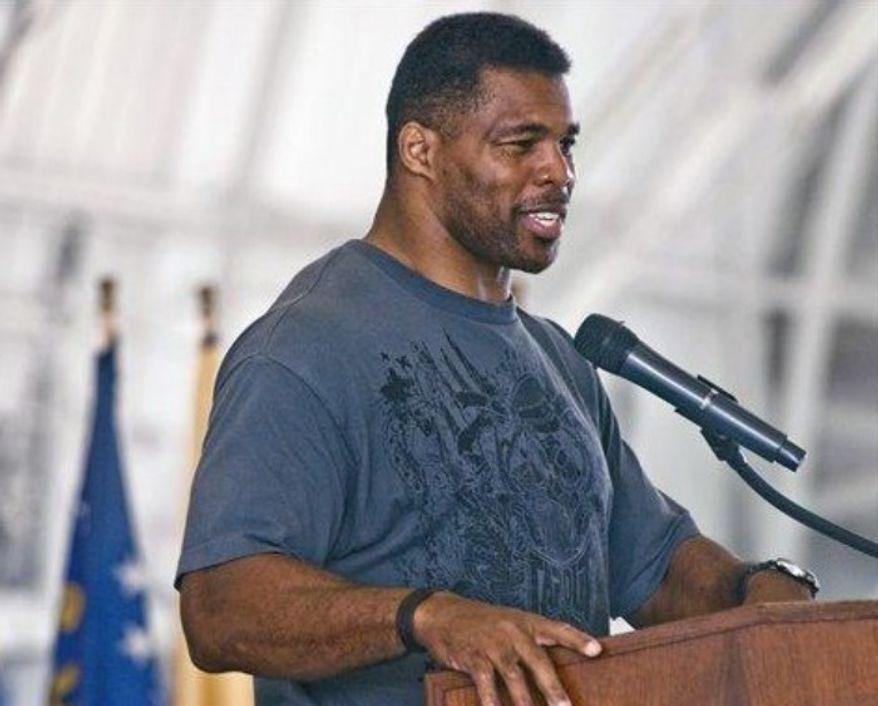 Former NFL football player Herschel Walker speaks to airmen Thursday, March 22, 2012, at Eglin Air Force Base, Fla. (Associated Press) ** FILE **