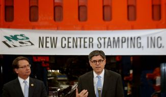 U.S. Treasury Secretary Jack Lew, right, speaks during a visit to the New Center Stamping facility in Detroit Friday, April 25, 2014, as Congressman Gary Peters look on. (AP Photo/Detroit Free Press, Regina H. Boone)  DETROIT NEWS OUT, TV OUT, INTERNET OUT, MAGS OUT, NO SALES, MANDATORY CREDIT