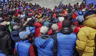 This April 24, 2014 photo released by Adrian Ballinger, founder and head guide of Alpenglow Expeditions, shows a meeting between Nepalese government delegation and Sherpa mountain guides near Everest base camp, Nepal. Nepal's attempts to salvage the Mount Everest climbing season took another hit Friday as more Sherpa mountain guides packed and left the base camp for their village homes a week after the deadliest disaster on the world's highest mountain. (AP Photo/Alpenglow Expeditions, Adrian Ballinger)