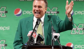 New Marshall University head basketball coach Dan D'Antoni gestures during an introductory news conference Friday, April 25, 2014, at the Marshall University Memorial Student Center in Huntington, W.Va. (AP Photo/The Herald-Dispatch, Sholten Singer)