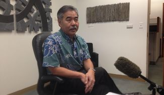 Hawaii State Sen. David Ige talks about the state budget and the land preservation deal on Oahu's North Shore in his office Thursday April 24, 2014. Hawaii lawmakers are confronting a deadline to pass the state budget, but they're still deciding how to work out key issues that include a historic land-preservation deal and funding for a slew of nonprofits. (AP Photo/Cathy Bussewitz)