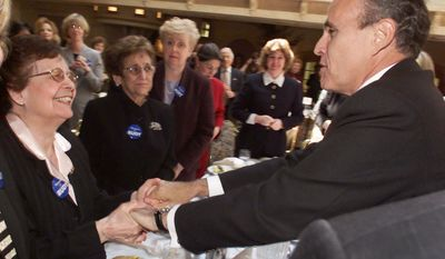 FILE - In this April 13, 2000 file photo, New York Mayor Rudolph Giuliani is greeted by Antoinette D'Amato, left, mother of former Sen. Alfonse D'Amato, while other supporters look on during a Women for Giuliani luncheon in Mineola, N.Y. Antoinette D'Amato died Thursday, April 24, 2014, at her home in Island Park, N.Y. She was 99. (AP Photo/Richard Drew, File)