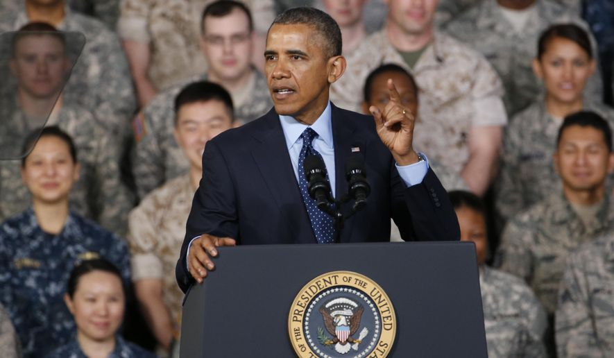 President Obama addresses U.S. military personnel at Yongsan Army Garrison in Seoul on April 26, 2014. Obama is wrapping up his two-day visit to South Korea and will continue to Malaysia and the Philippines on his four-country Asia visit. (AP Photo/Charles Dharapak) **FILE**