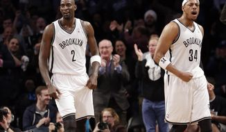 Brooklyn Nets' Paul Pierce (34) and Kevin Garnett (2) react after a play during the first half of Game 3 of an NBA basketball first-round playoff series against the Toronto Raptors on Friday, April 25, 2014, in New York. (AP Photo/Frank Franklin II)