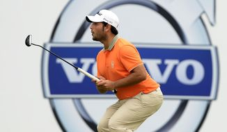 In this photo released by OneAsia, Alexander Levy of France  plays a shot during the second round of the Volvo China Open at Genzon Golf Club in Shenzhen, southern China Friday, April 25, 2014.  (AP Photo/OneAsia, Paul Lakatos) NO LICENSING