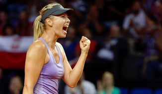 Russia's Maria Sharapova reacts during her quarterfinal match against Poland's top seed Agnieszka Radwanska at the Porsche tennis Grand Prix in Stuttgart, Germany, Friday, April 25, 2014. Sharapova won the match with 6-4 and 6-3. (AP Photo/dpa,Daniel Maurer)