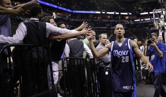 Dallas Mavericks' Devin Harris (20) walks off the court following Game 2 of the opening-round NBA basketball playoff series against the San Antonio Spurs, Wednesday, April 23, 2014, in San Antonio. Dallas won 113-92. (AP Photo/Eric Gay)