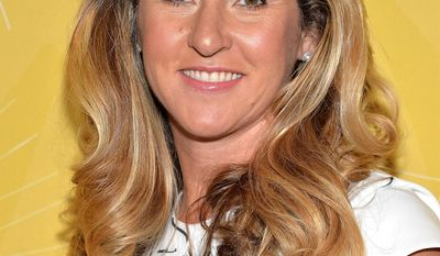 """President and CEO of A+E Networks, Nancy Dubuc, attends Variety's """"Power of Women: New York"""" luncheon at Cipriani Midtown on Friday, April 25, 2014 in New York. (Photo by Evan Agostini/Invision/AP)"""