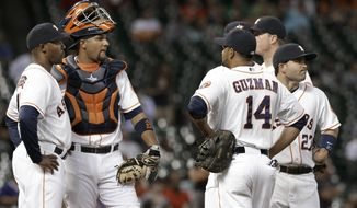 Houston Astros manager Bo Porter, left, catcher Carlos Corporan, Jesus Guzman (14) and Jose Altuve (27) wait after relief pitcher Paul Clemens was ejected in the seventh inning of a baseball game against the Oakland Athletics Thursday, April 24, 2014, in Houston. (AP Photo/Pat Sullivan)