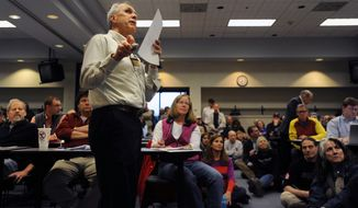 In this photo taken on Thursday, April 24, 2014, Michigan State University Extension professor Curtis Talley speaks during a meeting at the Washtenaw Intermediate School District about plans to drill for oil or natural gas in an area west of Ann Arbor, Mich.  A standing-room-only crowd of more than 300 people turned out for a meeting, with many expressing opposition to any drilling. (AP Photo/The Ann Arbor News, Brianne Bowen)  LOCAL TV OUT; LOCAL INTERNET OUT