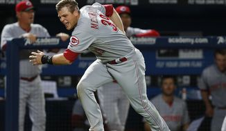 Cincinnati Reds catcher Devin Mesoraco (39) runs home to score on a Cincinnati Reds center fielder Billy Hamilton (6) double after falling down anon injuring himself in the seventh inning of a baseball game against the Atlanta Braves Friday, April , 25, 2014 in Atlanta. (AP Photo/John Bazemore)