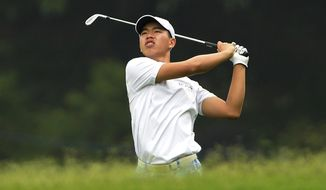 In this photo released by OneAsia,  Guan Tianlang of China plays a shot during the second round of the Volvo China Open at Genzon Golf Club in Shenzhen, southern China Friday, April 25, 2014.  Fifteen-year-old Guan, a year removed from his breakout performance at the Masters, failed to make the cut at the China Open on Friday, shooting a 76 to finish at 3-over 147. (AP Photo/OneAsia, Paul Lakatos) NO LICENSING
