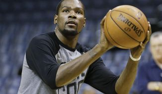 Oklahoma City Thunder forward Kevin Durant shoots during practice Friday, April 25, 2014, in Memphis, Tenn. The Thunder face the Memphis Grizzlies on Saturday in Game 4 of their opening-round NBA basketball playoff series. The Grizzlies lead the series 2-1. (AP Photo/Mark Humphrey)