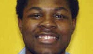This undated photo provided by the Ohio Dept. of Rehabilitation and Corrections shows Brandon Moore. The Ohio Supreme Court plans to hear an appeal from Moore, who claims a 115-year prison sentence imposed when he was 15 years old violates his constitutional rights. Moore was tried as an adult and convicted by a jury in the 2001 armed kidnapping, robbery and gang rape of a 21-year-old woman. (AP Photo/Ohio Dept. of Rehabilitation and Corrections)